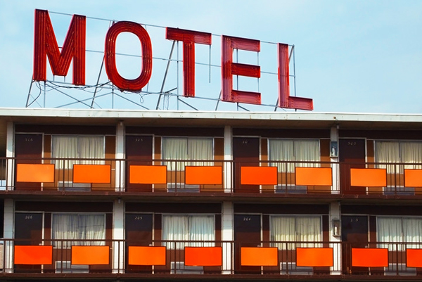 Large MOTEL sign above a retro-era motel