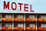 Large MOTEL sign above a retro-era motel